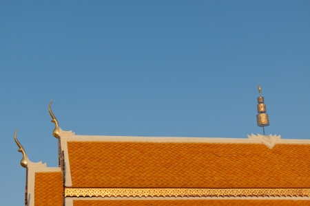Thai temple roof and  blue sky. photo