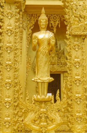 New golden buddha statue in Thai temple, Thailand  Stock Photo