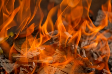 burning money: Image of burning phony money, in the tradition of Chinese New Year