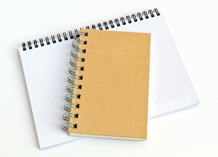 Brown and white notebook on white background  photo