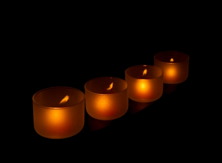 ambiance: Light of candles in dark night Stock Photo