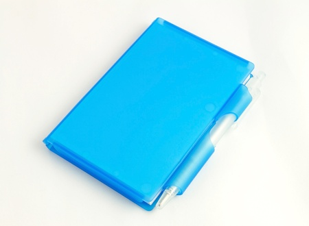Blue nootbook and pen on white background photo