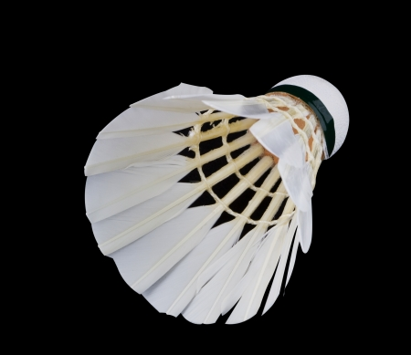 Shuttlecock isolated on black photo