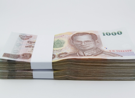 Stacked of Thai cash on white background