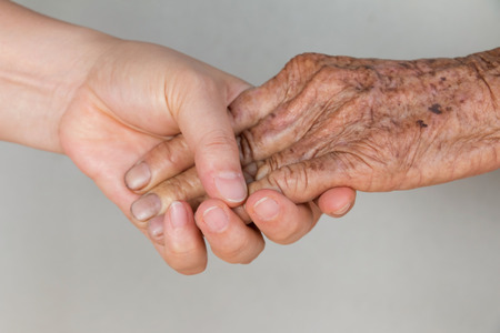 Senior woman hand and young woman hand
