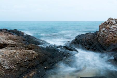 Stone seashore in cloudy morning