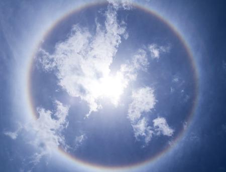 Corona, ring of sun with blue sky photo
