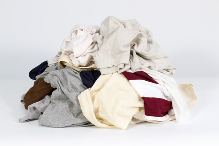 pile reuse: Pile of old clothes on white background Stock Photo