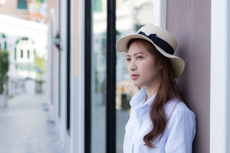 korean style house: Portrait of naturally Asian woman looking for something Stock Photo