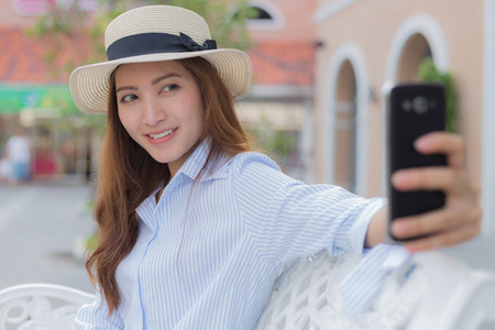 Shoping: A beautiful girl taking selfie