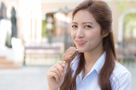 Happy woman eating ice cream