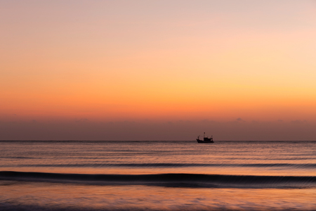 Fisherman in sunrise sky Stock Photo
