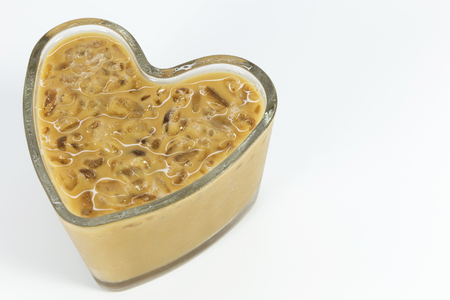 Ice coffee in heart shaped on white background