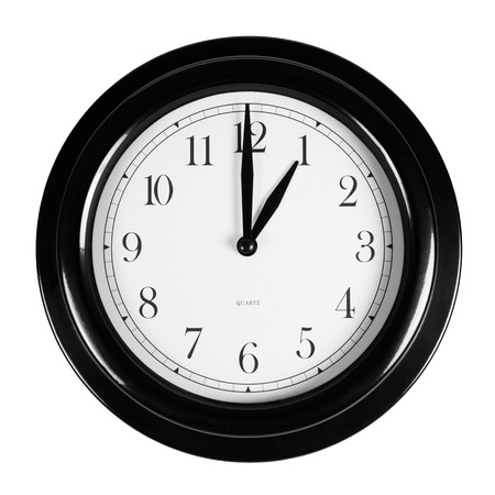 One oclock on the black wall clock, isolated on white Stock Photo