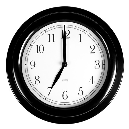 Seven oclock on the black wall clock, isolated on white
