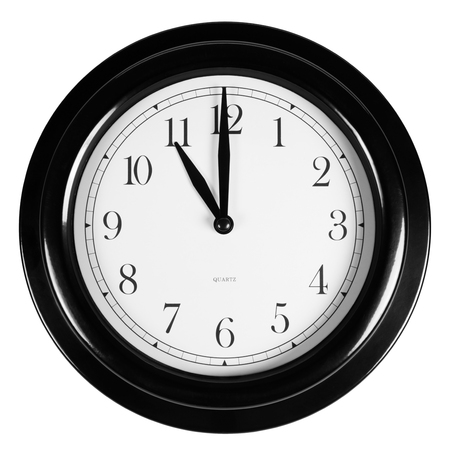 Eleven oclock on the black wall clock, isolated on white Stock Photo