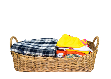 Clothes in basket isolated on white