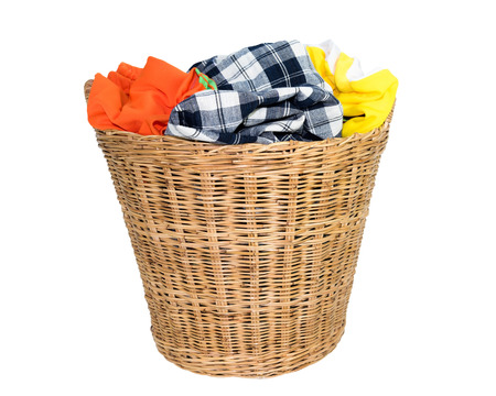 Colorful clothes in basket isolated on white Stock Photo