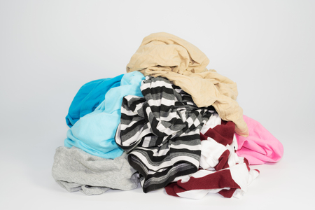pile of clothes on white background Stock Photo