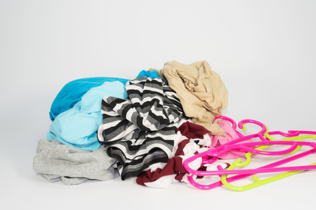 Pile of clothes with hanger on white background Stock Photo