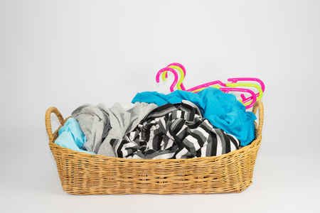 Pile of clothes in wicker basket