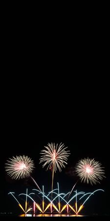 Vertical background. Real fireworks celebration at night background with copy space for text or anything else.