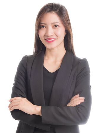 A businesswoman in a black suit with arms crossed and smiling face isolated on white background.