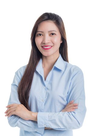 Asian woman in blue shirt arms crossed with a smiling face isolated on white