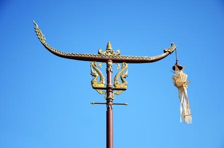 Thai-lanna pole with lanna lamp and gloden dragons photo