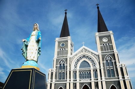 Virgin Mary statue on church background photo