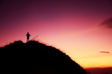 standing stone: Woman stands on top of the mountain in twilight scene  Thailand  Stock Photo