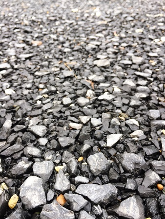 rough: A rocky road consisting of different sizes and colors of stones. Stock Photo