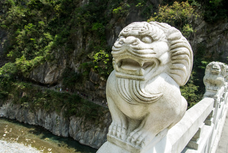 Marble Lion with the  excavated channel on cliff background