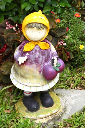 Doll decorated at garden