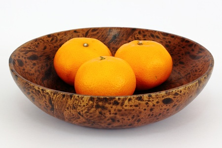 Oranges in a wooden bowl