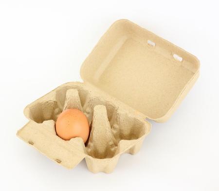 茶色のカートンで卵 写真素材