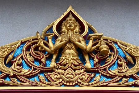 sculpture over the door in Thai temple photo
