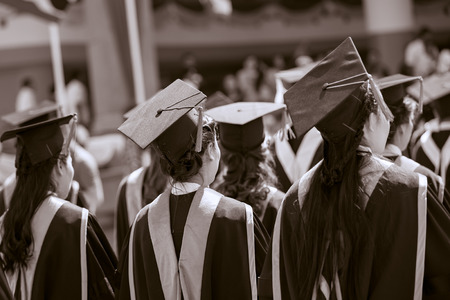 Graduates are stand up in line to get your degree ,sepia tone.