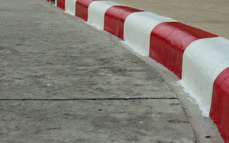emergency lane: red -white traffic lines on footpath Stock Photo