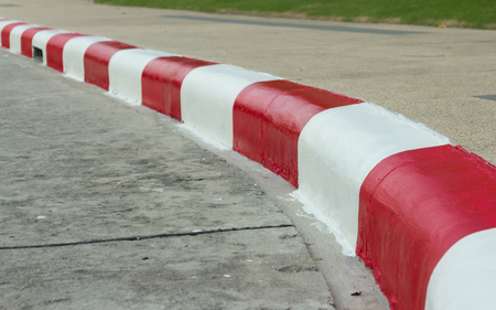 red and white: red -white traffic lines on footpath Stock Photo