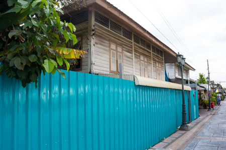 metal sheet: blue wall metal sheet and wooden house Stock Photo