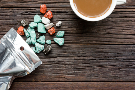 Chocolate candy and coffe on table in relax time Stock Photo