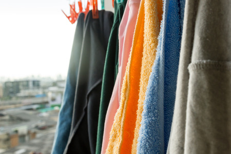 designer baby: clothes hanging to dry on a laundry line and sun shining