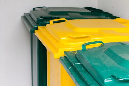 yellow and green garbage bin Stock Photo