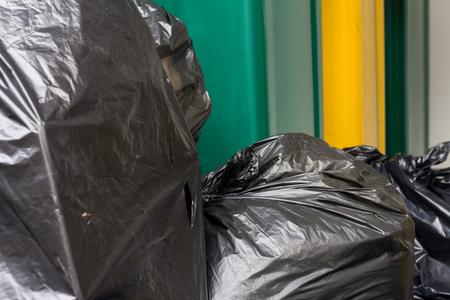 storage bin: bin with black garbage in waste storage Stock Photo