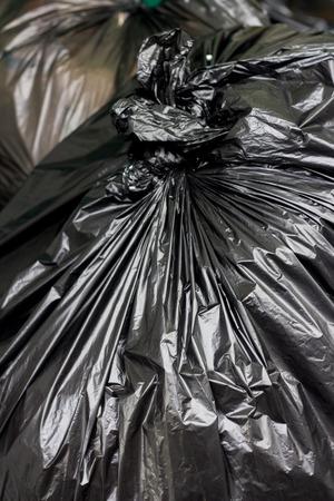 Background black garbage bag garbage dump Stock Photo