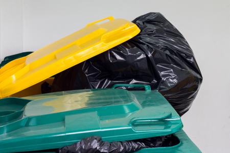 bin with black garbage in waste storage Stock Photo