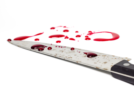 smeared: A knife smeared with blood on white background,isolate