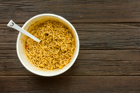 cooked instant noodle: Instant noodle on old wooden table