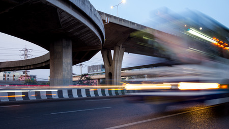 timelapse: abstract of busy traffic under the expressway at night in Bangkok city, Thailand Stock Photo